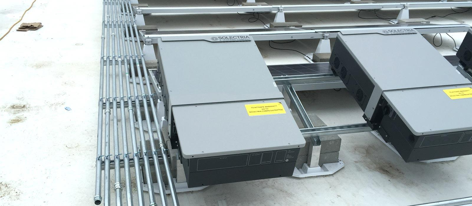 EcoMount closeup on commercial rooftop with solar inverters on top of each mount