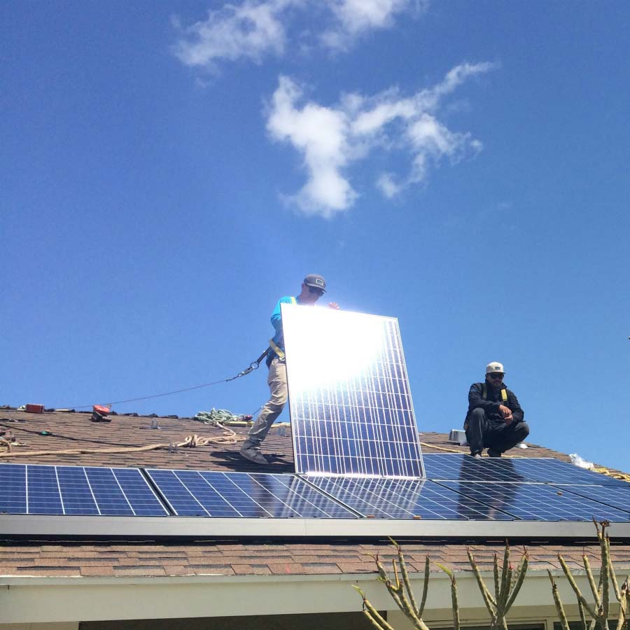 installers in los angeles working on rooftop to install ecox
